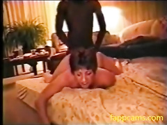Short-haired MILF relaxes in hotel room with black lover