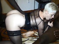 Blonde German milf in lingerie worships two big black cocks